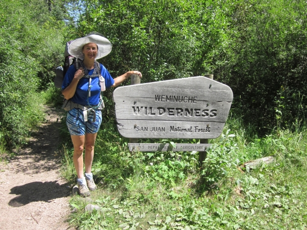 Vicki and the Weminuche Wilderness sign on the Pine River Trail