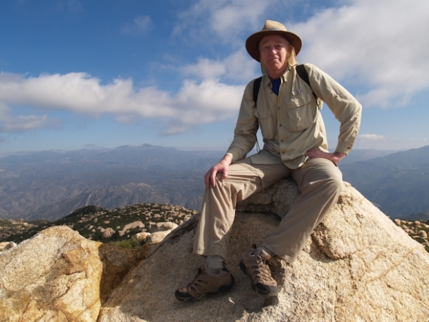Me sitting on the comfy granite summit block of El Cajon Mountain