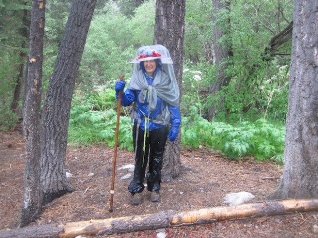 Vicki is resigned to the rain and hail, and ready to hike onward on the Dry Lake Trail